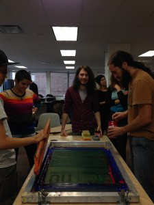 Participants in the Art for Action workshop in November making prints.